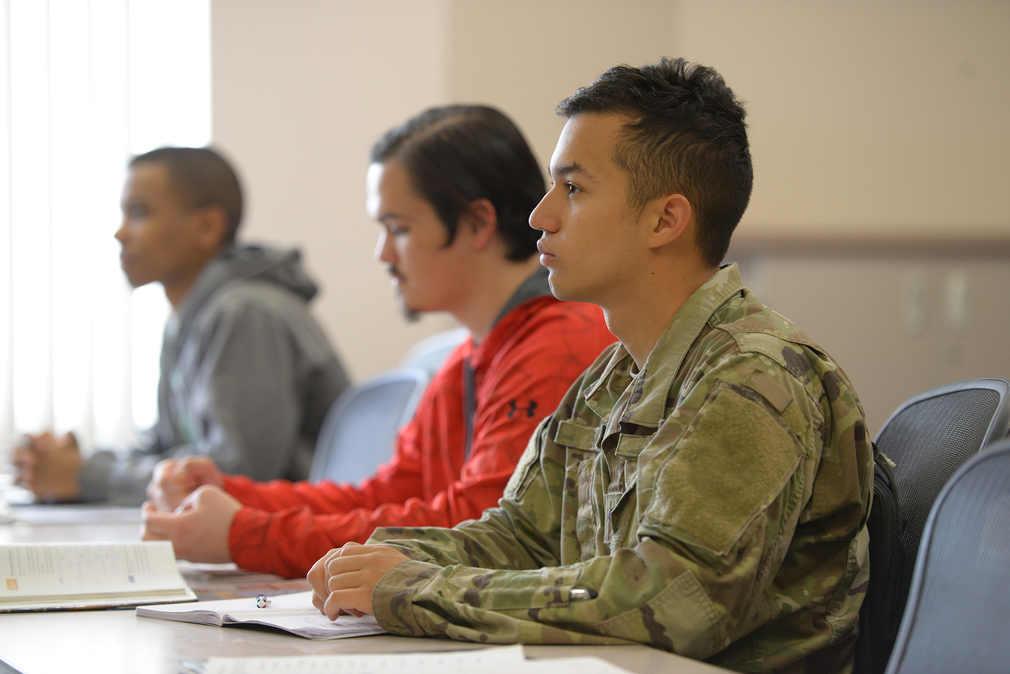 Military student studying in a classroom