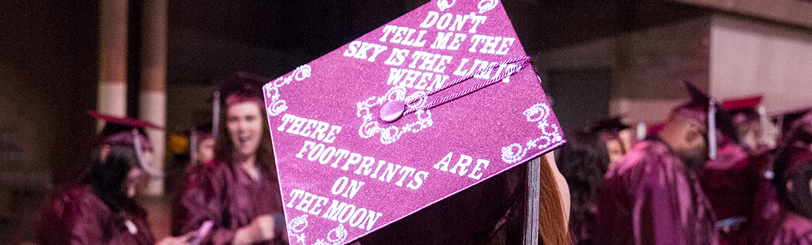 "Graduate hat that says ""Don't tell me the sky is the limit when there are footprints on the moon"""